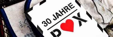 Postkarte im Event-Design als Printprodukt zum Jubiläumsevent bei Total Mittedeutschland.